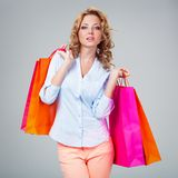 Woman holding blank card and bags Royalty Free Stock Photo