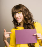 Woman holding blank card. Stock Image