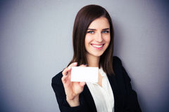 Woman holding blank card. Focus on woman Stock Photography
