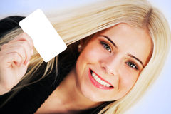 Woman holding a blank card Royalty Free Stock Images
