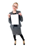 Woman holding blank card. Isolated on white background Stock Images
