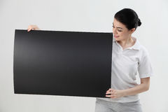 Woman holding blank card Stock Image