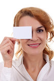 Woman holding blank card over her eye Stock Photo