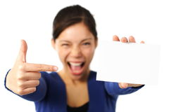 Woman holding blank card / white sign. White sign or notecard. Very excited mixed caucasian / asian business woman pointing at blank card. Isolated on white Stock Photography