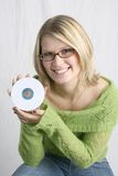 Woman Holding Blank CD. Cute Woman holding a Blank CD royalty free stock photo
