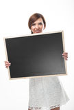 Woman holding a blank chalkboard Royalty Free Stock Images