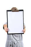 Woman holding a blank clipboard Royalty Free Stock Image