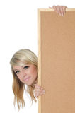 Woman holding a blank corkboard Stock Photo
