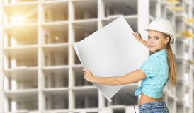 Woman holding blank drawing sheet in front of Stock Photos