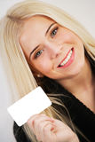 Woman holding a blank card Royalty Free Stock Photos