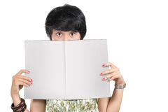 Woman holding blank magazine. Shot of woman holding a blank magazine Royalty Free Stock Photos