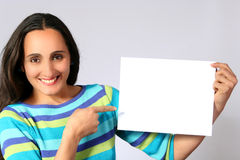 Woman holding a blank paper Stock Photo