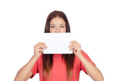 Woman holding a blank paper covering her mouth. Isolated on white background Royalty Free Stock Photos