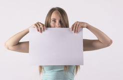Woman holding blank paper. Empty copyspace for ads Royalty Free Stock Image