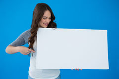 Woman holding a blank placard Stock Images