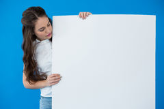 Woman holding a blank placard Royalty Free Stock Photography