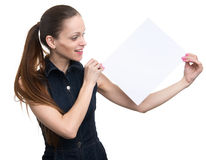 Woman holding a blank placard. Isolated Royalty Free Stock Images
