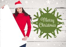 Woman holding blank placard with merry christmas greetings Stock Image