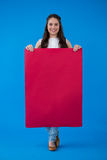 Woman holding a blank placard Stock Photography