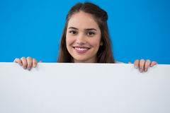 Woman holding a blank placard Royalty Free Stock Images