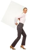 Woman holding blank poster. Young woman over white background Stock Photos