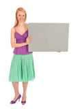 Woman holding blank poster. Standing over white background Royalty Free Stock Image
