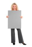 Woman holding blank poster board. Beautiful woman holding blank poster board Stock Photo