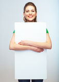 Woman holding blank poster isolated portrait. Stock Image