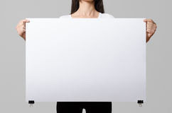 Woman holding a blank poster. Stock Images