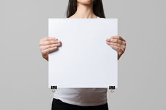 Woman holding a blank poster. Stock Image