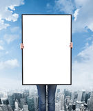 Woman holding a blank poster Royalty Free Stock Photography