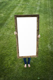 Woman Holding Blank Rectangular Frame Stock Image