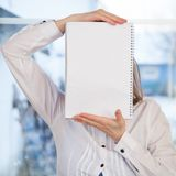 Woman holding blank ring-bound notebook Royalty Free Stock Photo