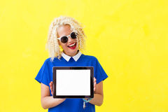Woman holding blank screen tablet in her hands Stock Photos