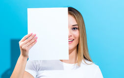 Woman holding a blank sheet of paper Royalty Free Stock Photo