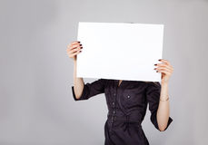 Woman holding a blank sheet of paper Royalty Free Stock Photography