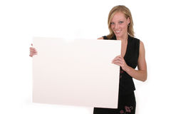 Woman Holding Blank Sign. Attractive smiling business woman holding blank sign with room for text stock photos