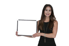 Woman Holding a Blank Sign. Beautiful young woman holding up a blank sign Royalty Free Stock Photo