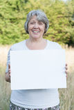 Woman holding blank sign Stock Photography