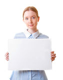 Woman holding blank sign paper. Young beautiful woman holding blank sign paper, isolated on white Royalty Free Stock Photos