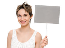 Woman holding blank sign. Woman showing blank empty sign card with copy space. Beautiful smiling young female on white background Royalty Free Stock Image