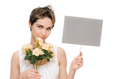 Woman holding blank sign. Woman showing blank empty sign card with copy space and flowers. Beautiful smiling young female on white background Royalty Free Stock Photos