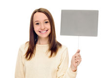 Woman holding blank sign. Woman showing blank empty sign card with copy space and flowers. Beautiful smiling young female on white background Royalty Free Stock Photography