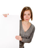 Woman holding blank sign. Woman showing blank empty with copy space. Beautiful smiling young female on white background Stock Photos