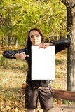 Woman holding a blank sign in woodland Stock Photos