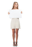 Woman holding a blank signboard Royalty Free Stock Photography