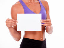 Woman holding blank signboard in front Stock Photography