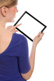 Woman holding a blank touchpad pc. Beautiful woman holding a blank touchpad pc, 1 finger touches the screen, you can add whatever you want in the screen stock images