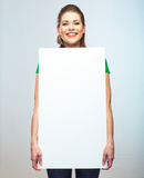 Woman holding blank white board isolated studio portrait. Royalty Free Stock Photos