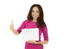 Woman holding a blank white board with thumb up Royalty Free Stock Photography